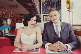 Bride and groom in American diner, make up by Powder Beauty in Brighton
